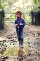 Child walking in the mud