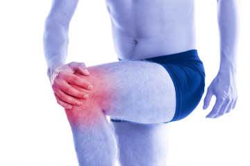 Man holds up for sore knee