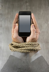businessman addicted to mobile phone rope bond addiction concept