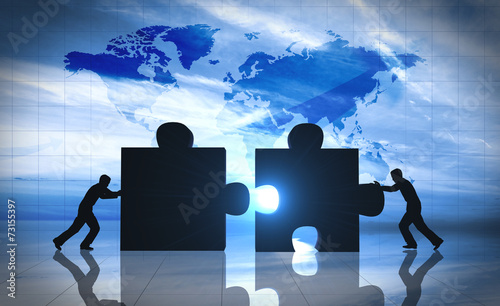 Leinwanddruck Bild World Business teamwork puzzle pieces