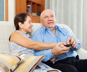 mature couple with TV remote