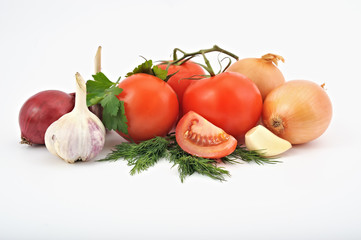 composition of vegetables on white background, onions, tomatoes,