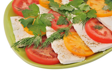 salad with tomatoes and mozzarella on an isolated background