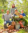 Happy  family in vegetable garden