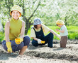 family sows seeds in soil