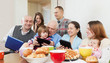 Happy multigeneration family using devices