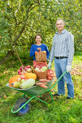 Man and woman with crop of vegetables