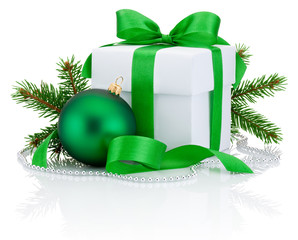 White box tied green ribbon bow, pine tree branch and christmas