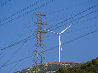 Wind turbines and high voltage electricity tower