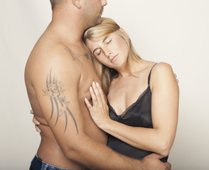 Woman on man's chest