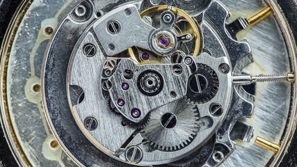 Macro view of mechanism of old watch