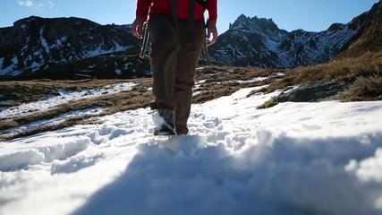 Hiker descending mountain range at sunset
