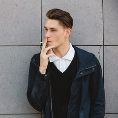 Fashion hipster male model smoking