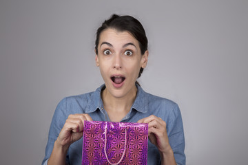 Attractive young woman with surprised expression