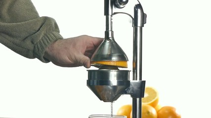 juicer and oranges on white background