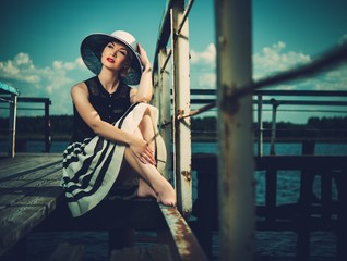 Beautiful woman on old wooden pier