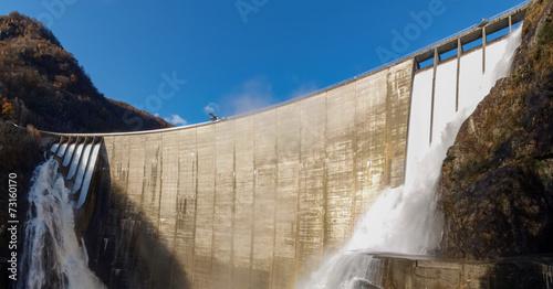Leinwanddruck Bild Dam of Contra Verzasca, spectacular waterfalls