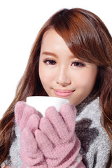 woman holding cup in winter