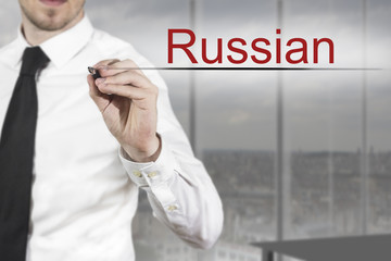 businessman writing russian in the air office
