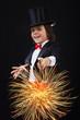 Young magician boy using his magic wand