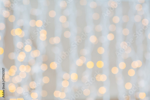 Leinwanddruck Bild blurred glden lights background