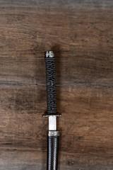 samurai sword on wood