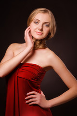 Portrait of beautiful young blonde in red dress