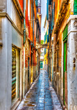 Narrow stone made street at Venice Italy. HDR processed