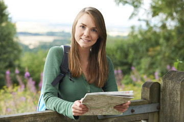 Portrait Of Young Woman Hiking In The Countryside