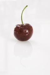 Moist Single Cherry on white background