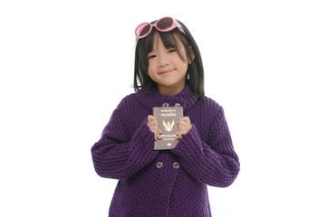 Little asian girl holding passport