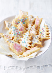 Iced Christmas cookies with sugar pearls