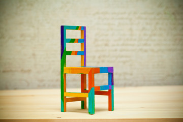 Toy multicolored wooden chair. Art handmade