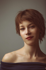 portrait of a young woman with short brown hair