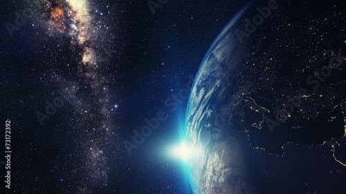 canvas print picture blue sunrise, view of earth from space with milky way galaxy