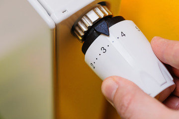Hand turning on/off the radiator