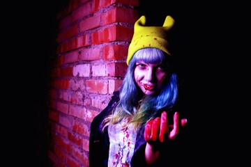 Portrait of funny zombie girl in halloween time