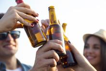 "Постер, картина, фотообои ""Portrait of group of friends toasting with bottles of beer."""