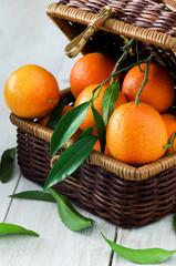 Tangerines in rustic basket