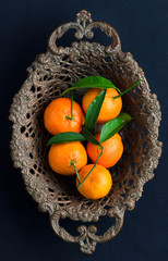 Tangerines in vintage bowl
