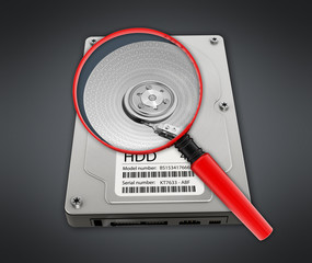 Magnifying glass on hard disk drive