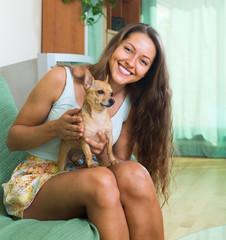 Smiling girl with Russkiy Toy Terrier