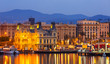 canvas print picture -  Barcelona from Port Vell in sunrise
