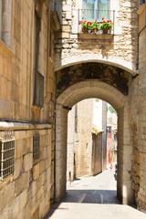 Arch over old narrow street of european city