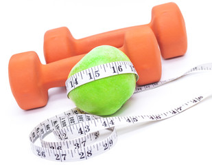 Green apple and a dumbbell