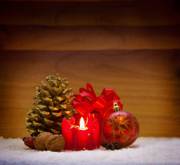 Red christmas decoraion and advent candle  isolated on wooden b