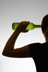 Silhouette of an alcoholic woman with a bottle