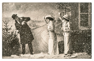 happy young people playing in snow. vintage christmas holidays p