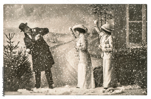happy young people playing in snow. vintage christmas holidays p - 73177305
