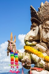 close-up statute of Ganesha outdoor against blue sky and white c